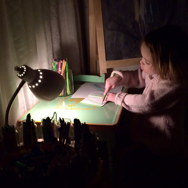 Kid art desk at night. Make a kids art area in your home. See more photos here: http://everclevermom.com/2014/01/create-a-toddler-art-corner-in-your-home/