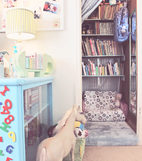 Closet turned into a library in playroom office combo. See more photos at http://everclevermom.com/2014/01/work-at-home-playroom-in-the-office-office-in-the-playroom/